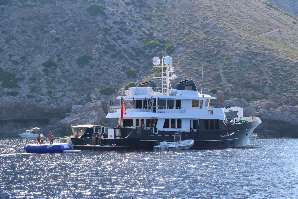 A large private yacht and a much smaller boat tied up beside were moored in the picturesque bay