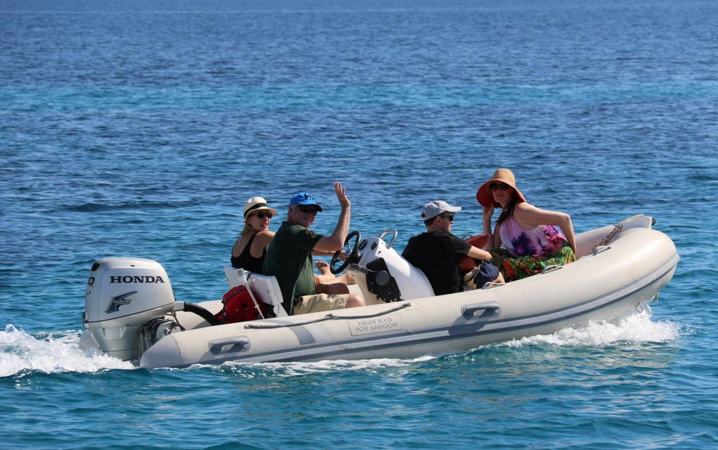 An Australian family who are cruising in the area, call past in their tender to say hello