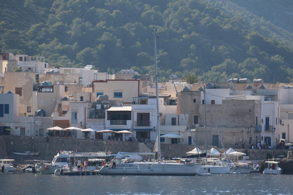 A couple of visiting yachts are moored in Scala Nuova by the town