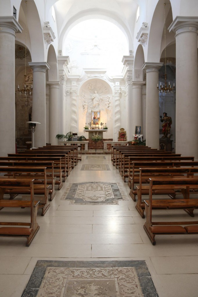 The beautiful interior of the church with it's white marble and inlaid floor
