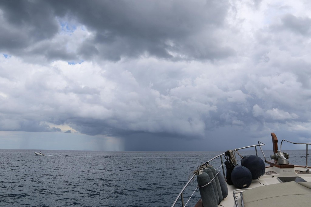 A thunderstorm approaches with threatening dark clouds