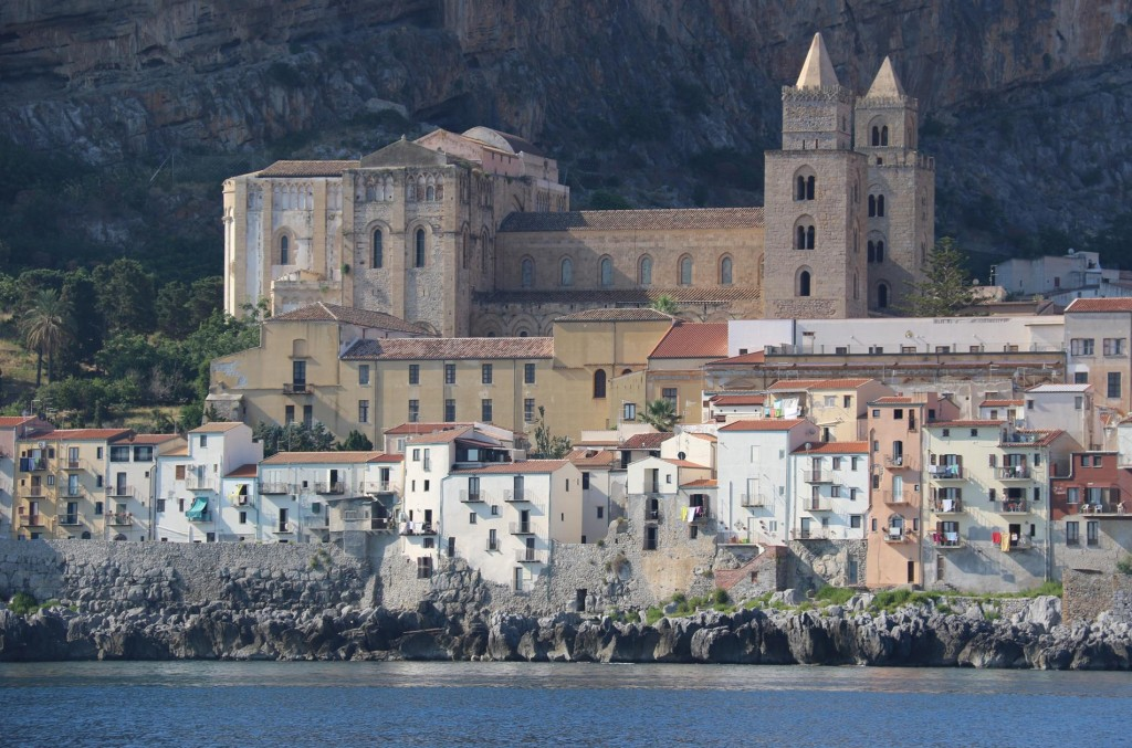 The splendid medieval Cathedral of Cefalu overshadows the fishermen's dwellings lining the seafront