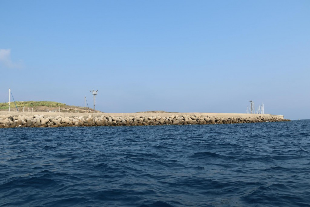 The breakwater of the new port by Cala Rossano