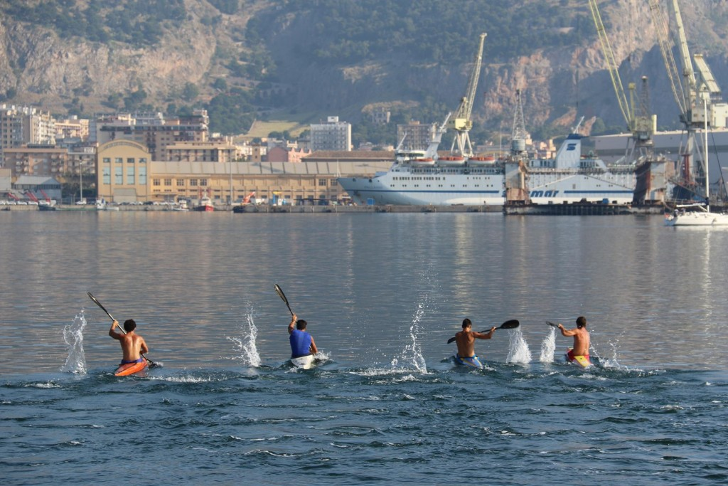 The Kayakers are having an early morning race in the calm conditions in the sheltered port