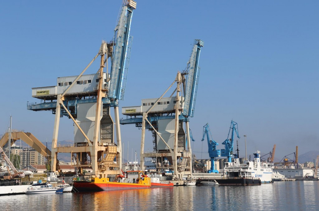 Heading out of the port the massive cranes loom overhead