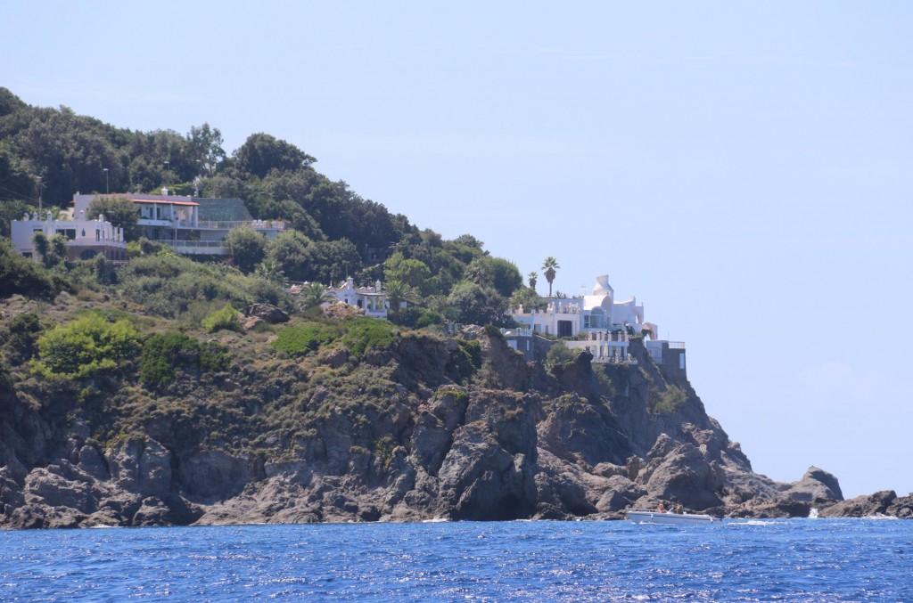 These villas are built directly over the rock cliffs by the waters edge