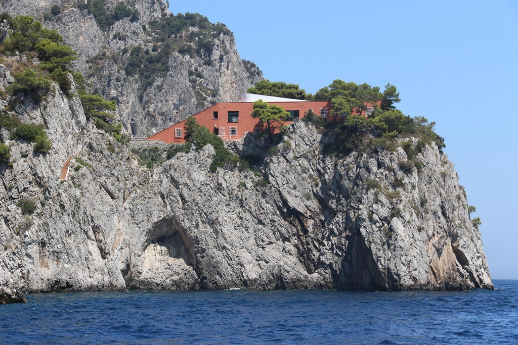 Continuing up the east coast of Capri we pass a few amazing houses built on the cliffs