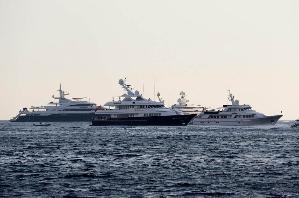 We counted over 20 superyachts were visible from one end of the bay to the other
