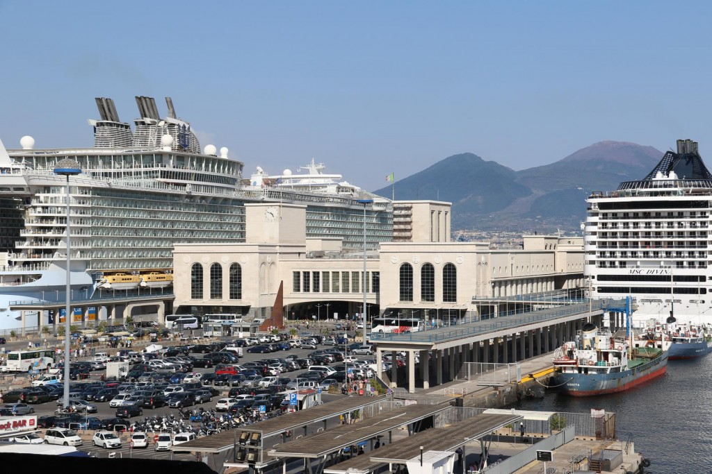 Mount Vesuvius can be seen between the gigantic cruise ships that are in Naples today