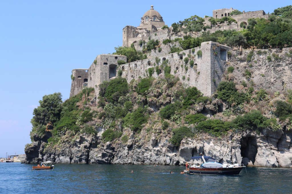 The Aragonese Castle stands on volcanic rock and was built in  474BC