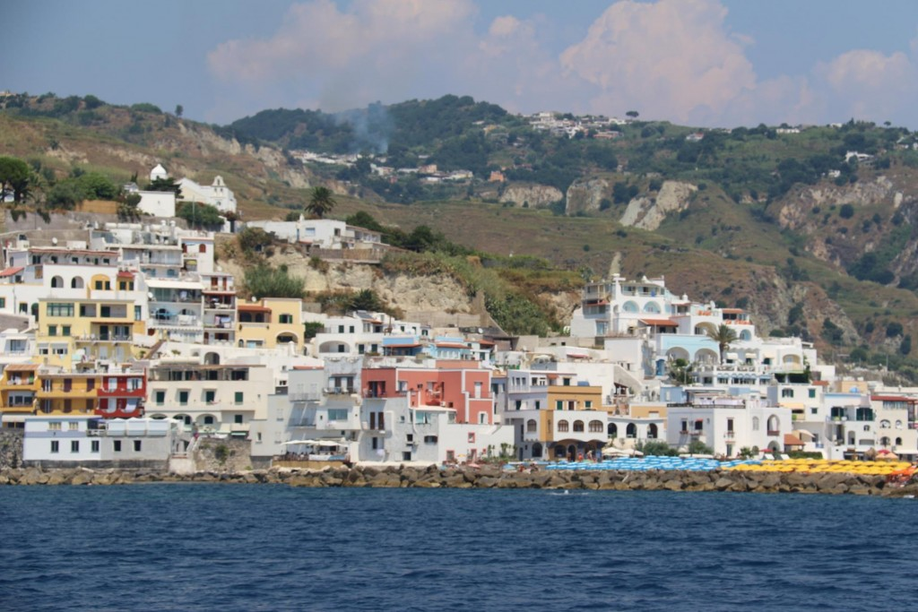 Attractive white washed houses cling to the cliffs while the coloured umbrellas have taken over the small beach here in Sant' Angelo