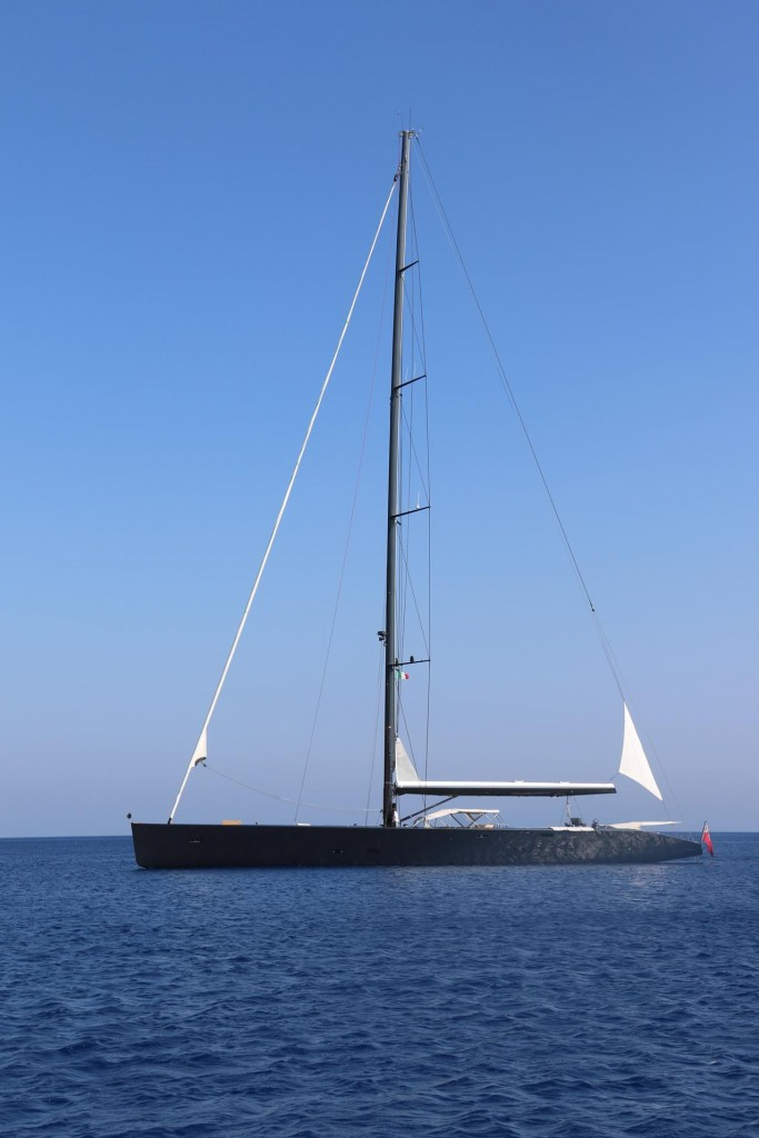 Nearby also on anchor was an amazing sleek black superyacht