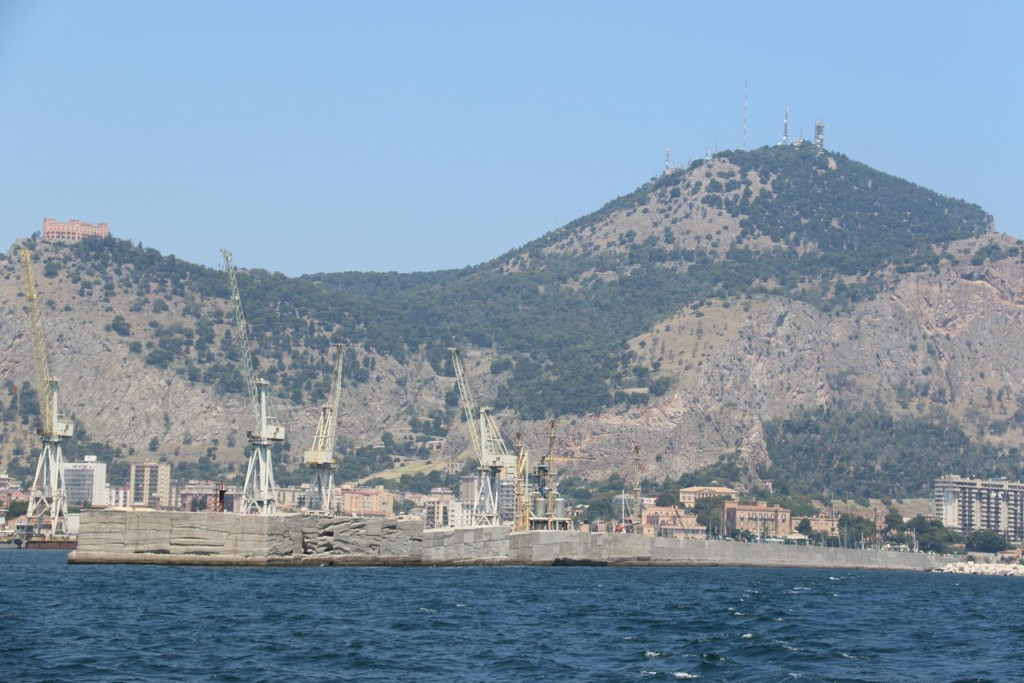 Finally the cranes and derricks from the commercial harbour of Palermo come into view