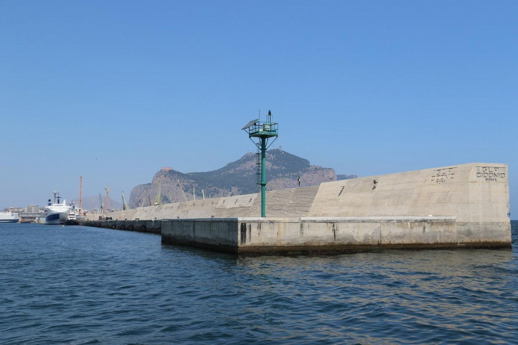 The very long harbour breakwater in Palermo cannot be easily missed