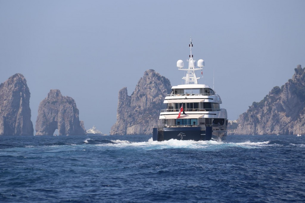 We follow a large yacht in the direction of the Favignano Rocks in south east Capri