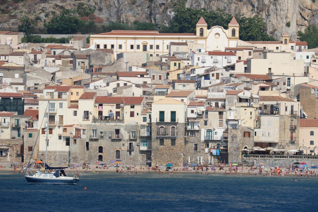 A long sandy beach runs along the foreshore by the ancient town