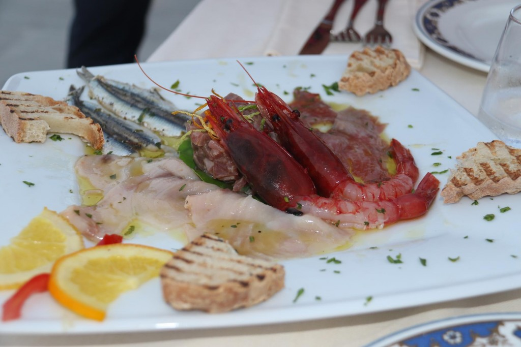 A plate of fresh raw seafood is one of the shared entrees