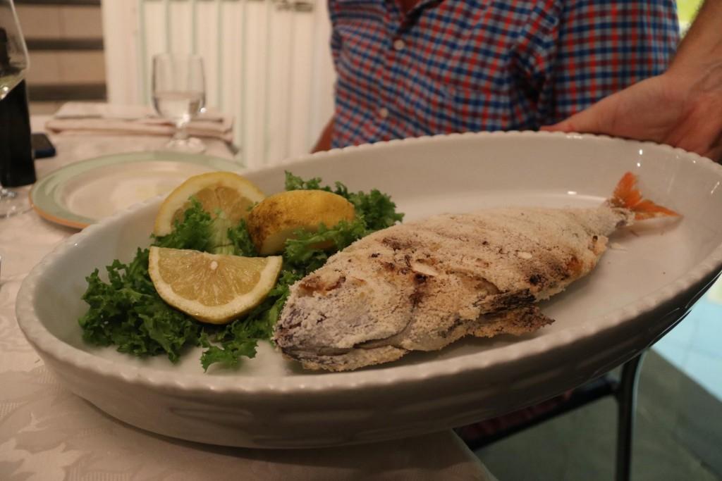 Fresh fish baked with a salt crust