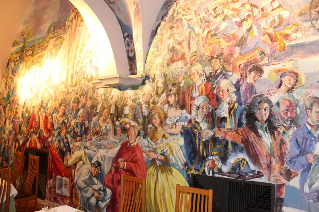 There is an amazing modern fresco painted on the entire wall in the restaurant