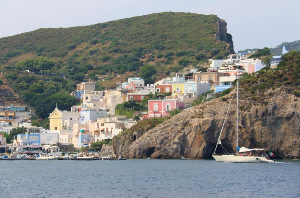 Pretty pastel houses creep up the hills around the Ponza harbour