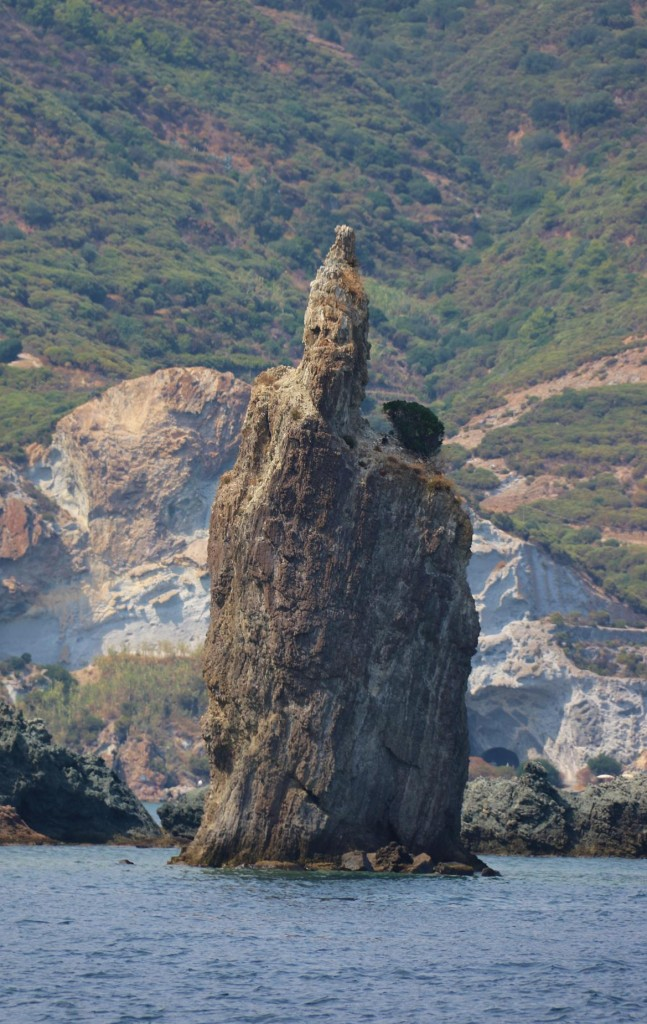 Many unusual rock statues appear to rise out of the water around Ponza