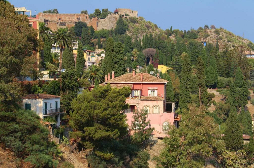 Beautiful villas nestle into the hillside by Taormina