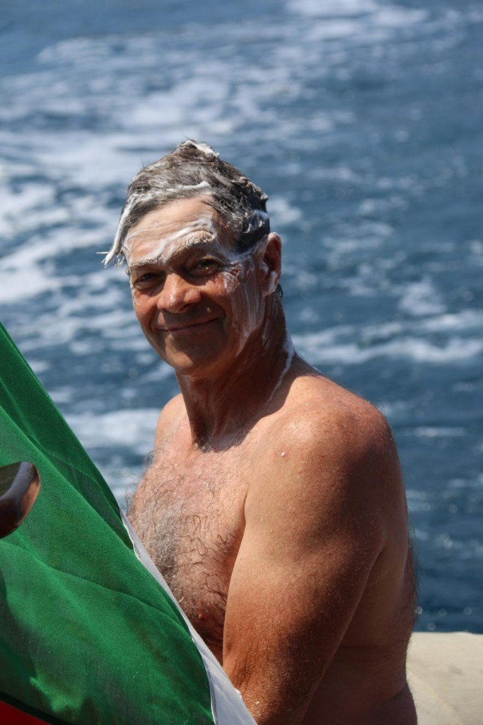 Don takes a shower on the stern of the boat as we travel back to mainland Sicily