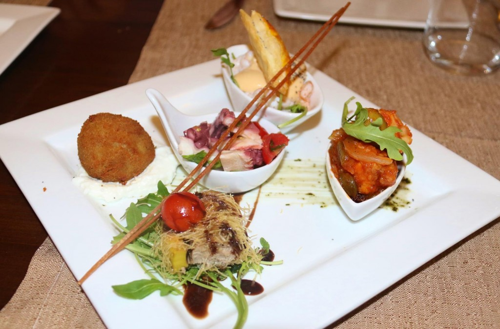 We share a couple of starter platters with traditional Sicilian food