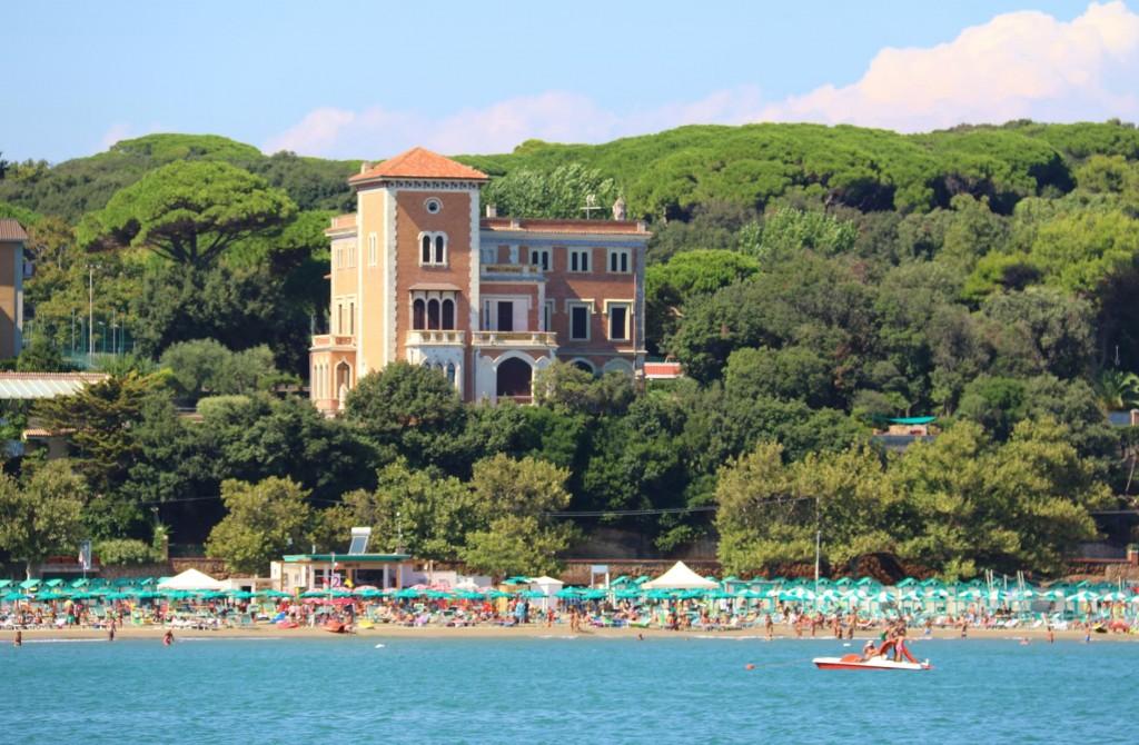 The long beach by Anzio has thousands of coloured umbrellas