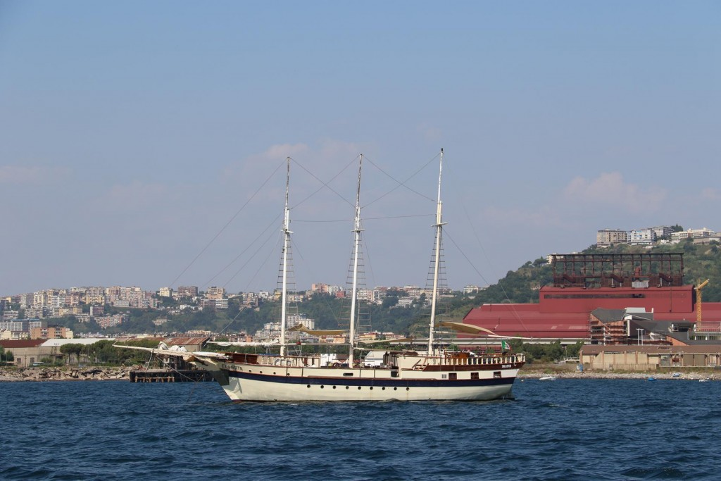 We join the only other boat in the bay and drop our anchor behind the  3 masted sailing boat