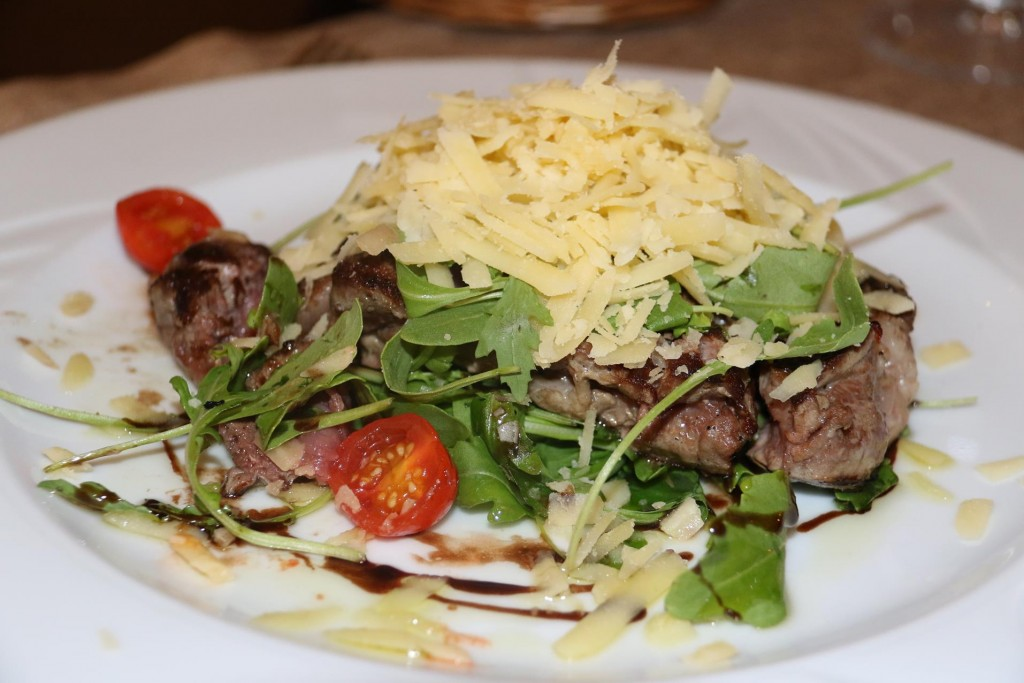 Ric enjoyed his steak which was covered in cheese and salad
