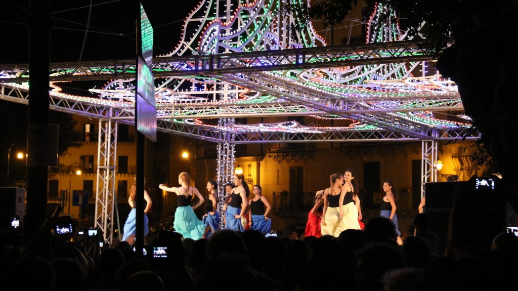 The festivities continue with dancers on a well lit stage
