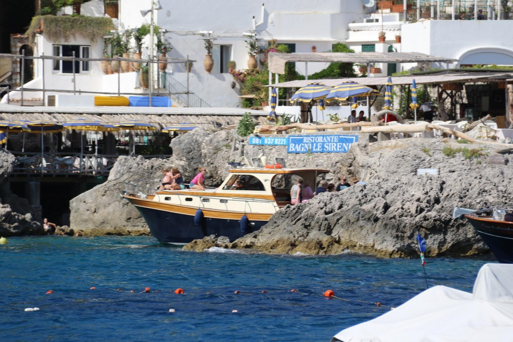 Many restaurants, some perched on the rocks can be found in this bay