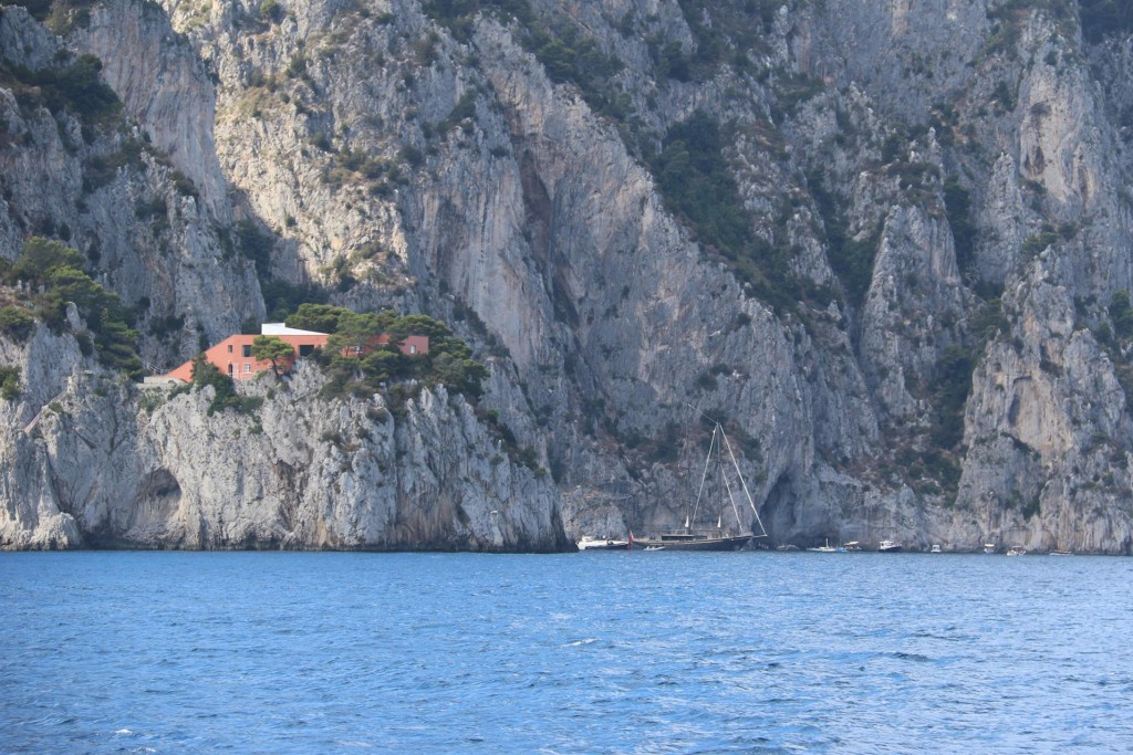 Houses are also perched high up on rocks around the island