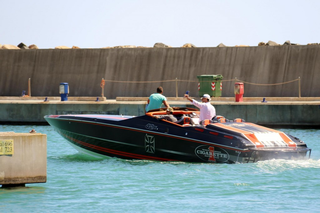 A very noisey racing boat leaves the marina