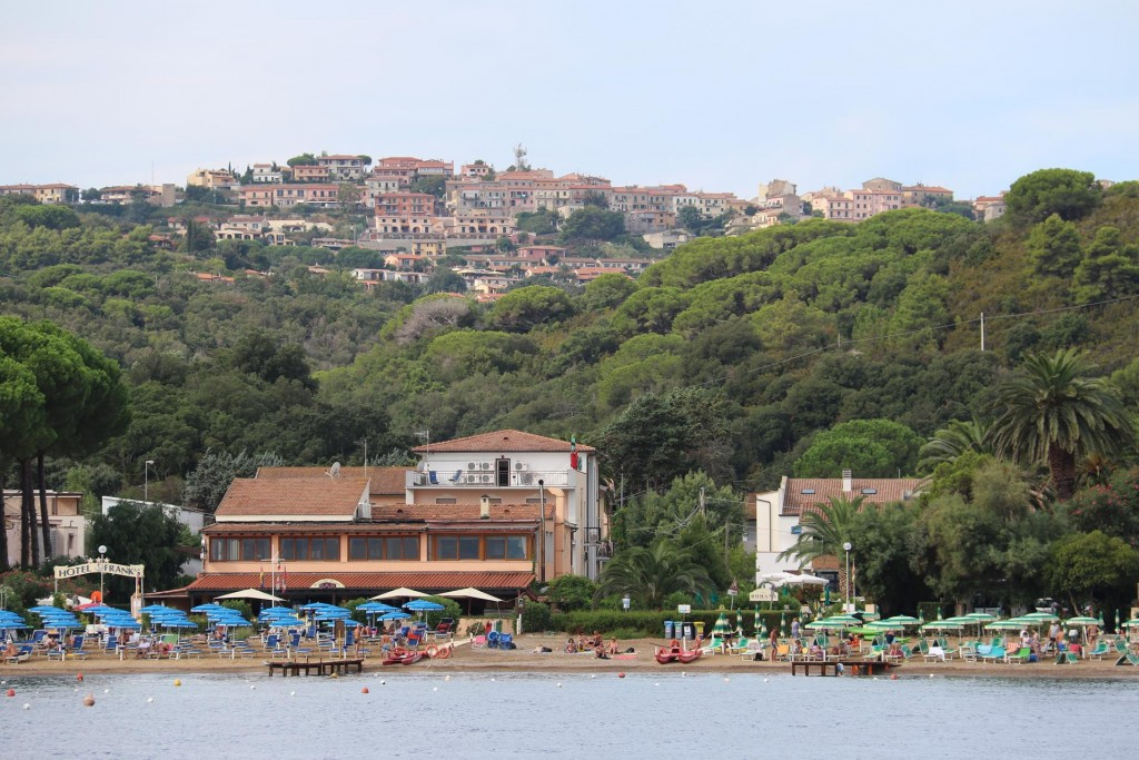 We pass Naregno Beach with Capoliveri in the background