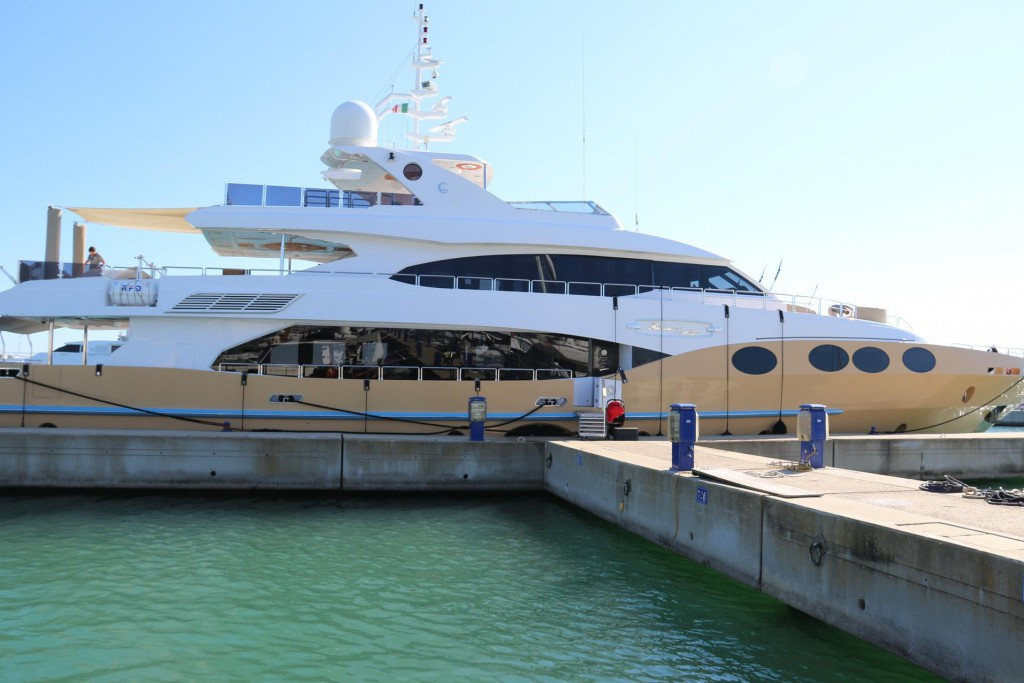 Late afternoon a large superyacht called 'Marina Wonder' moores nearby at the end of our pier