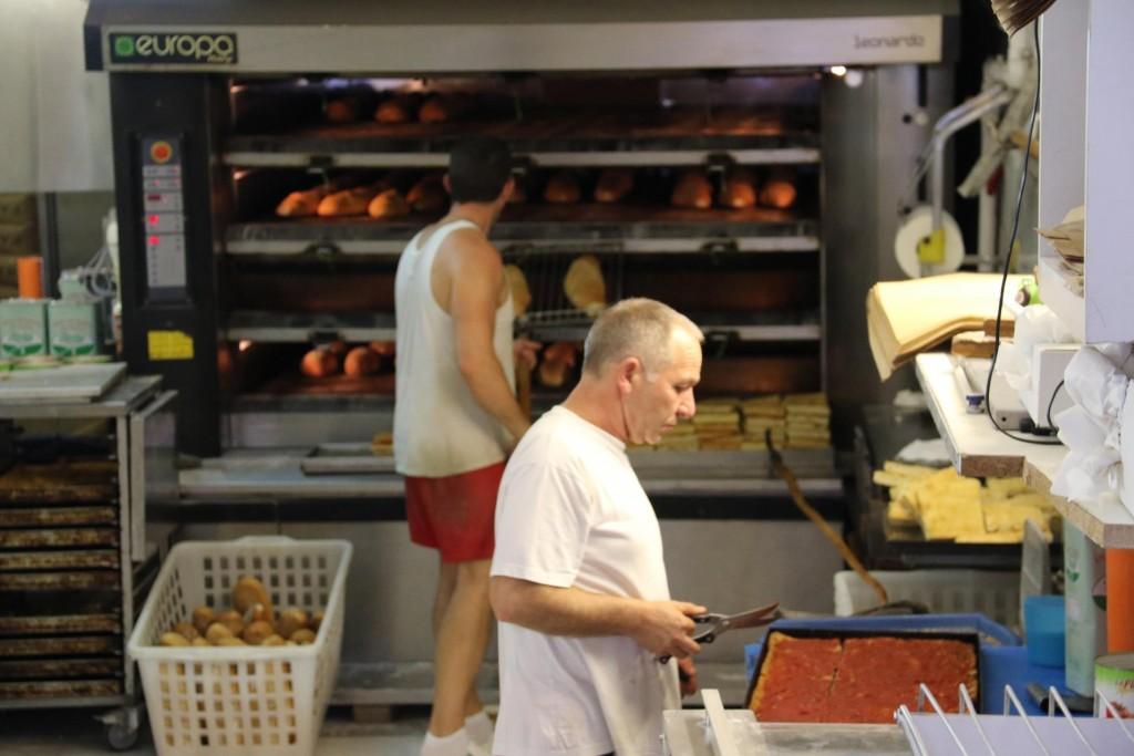 The bakers next door working hard in the heat