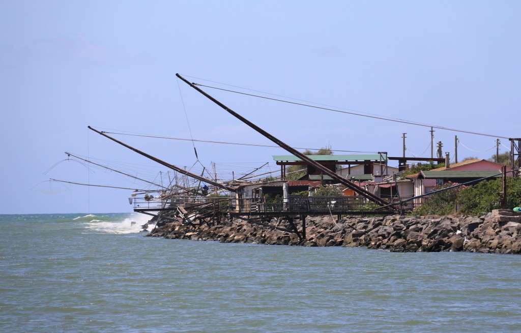 We return to the mouth of the river passing the fishing structures