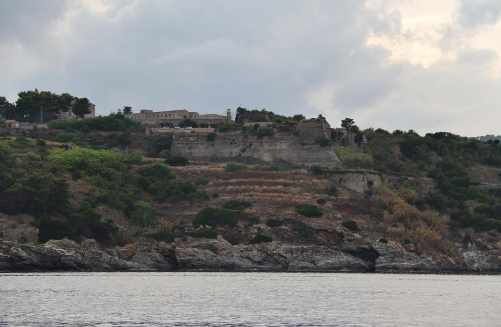 On the east coast of Elba as we enter Porto Azzurro we pass a citadel on a rocky promontotry