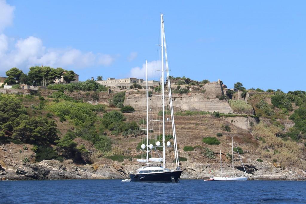 We pass the imposing San Giacomo Fort of Azzurro