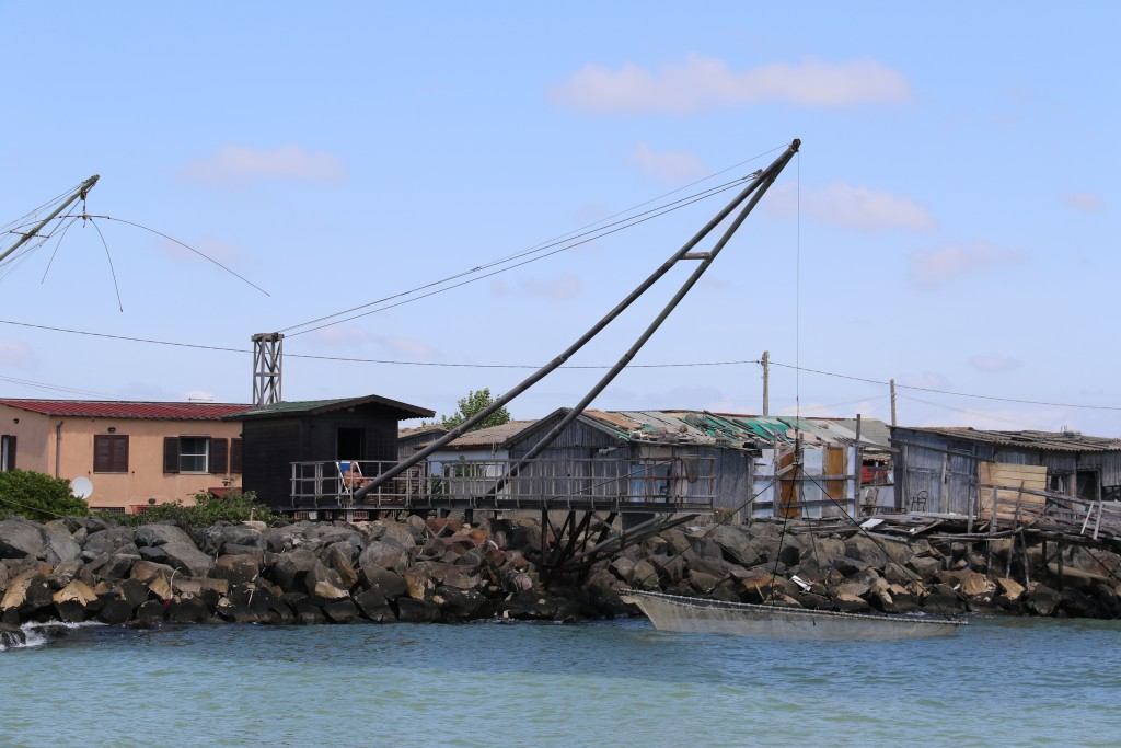 As we pass, a net is being lowered into the river