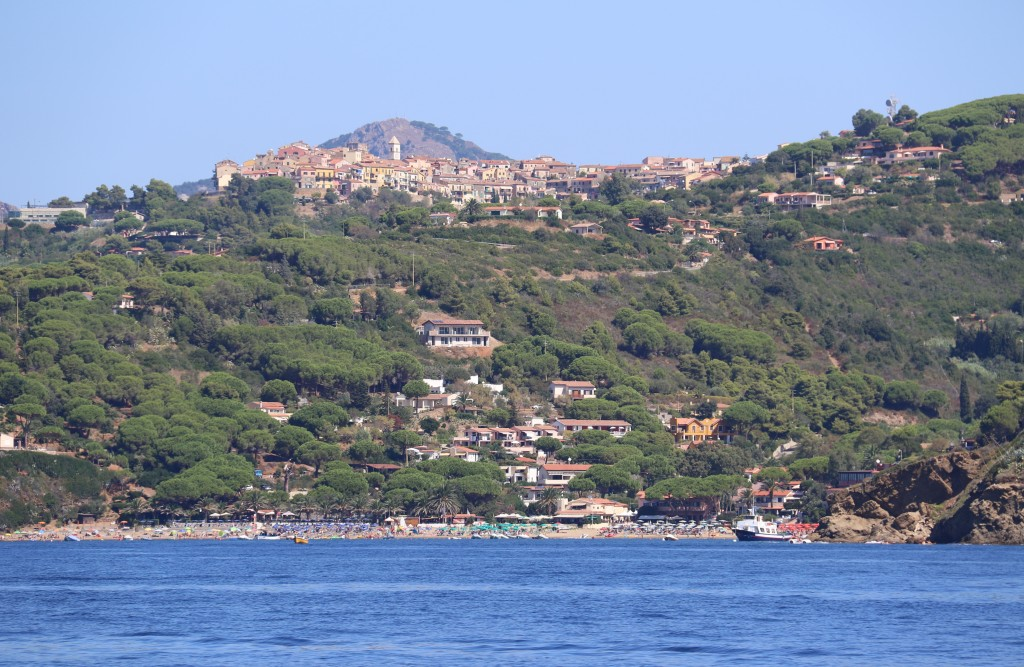 From Golfo Stella the ancient hilltop town of Capoliveri can be seen