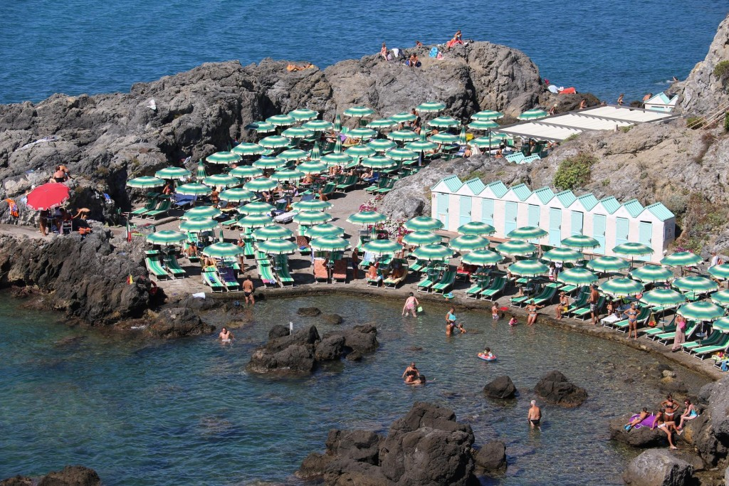 A popular swimming area in Talamone by the rocks