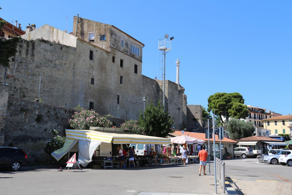 A few market stalls are conveniently set up by the port