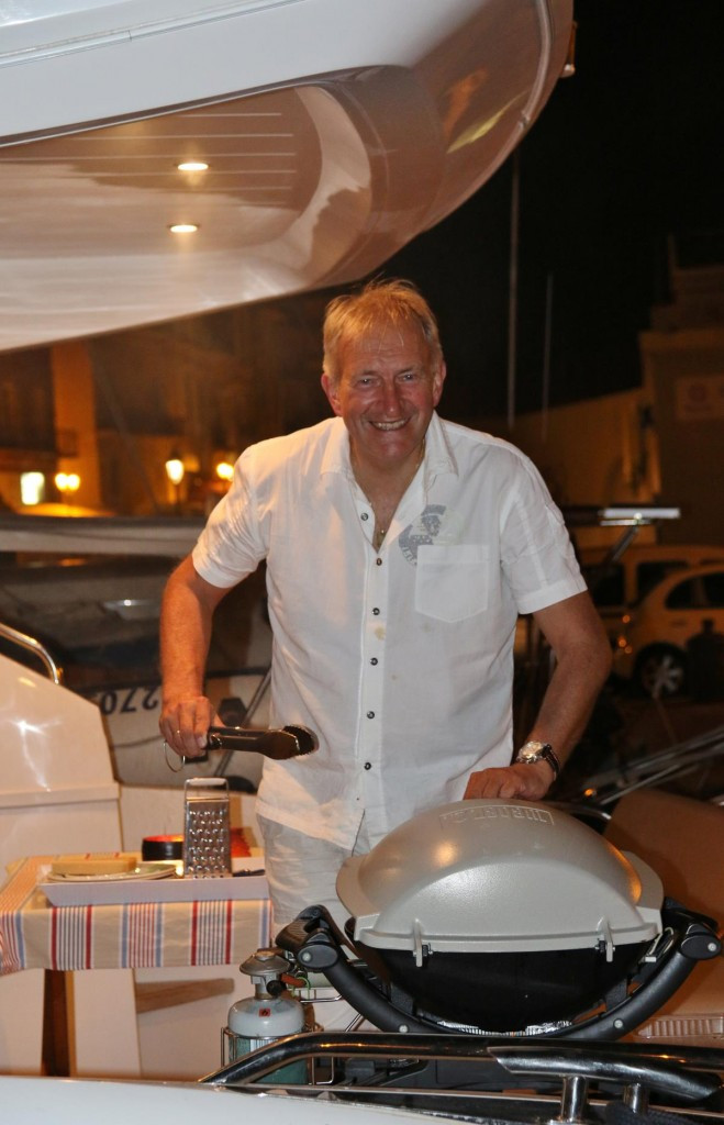 Francis from Brussels on the lovely boat beside us busy cooking on his Webber barbecue