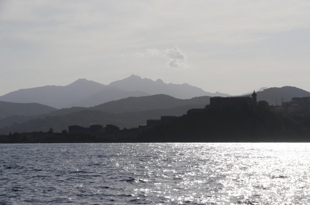 The outline of Portoferraio in the distance