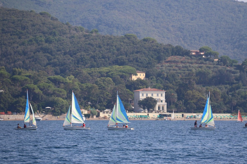 Sailing is very popular in the bay where Villa Toscanelli is in the background