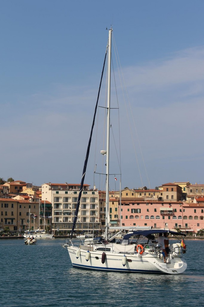 A young couple with their suitably named yacht 'Whatever' enter the port