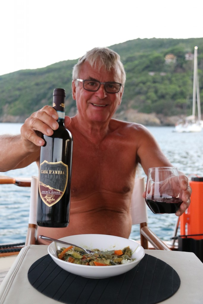 Ric opens a vino rosso to have with our curry